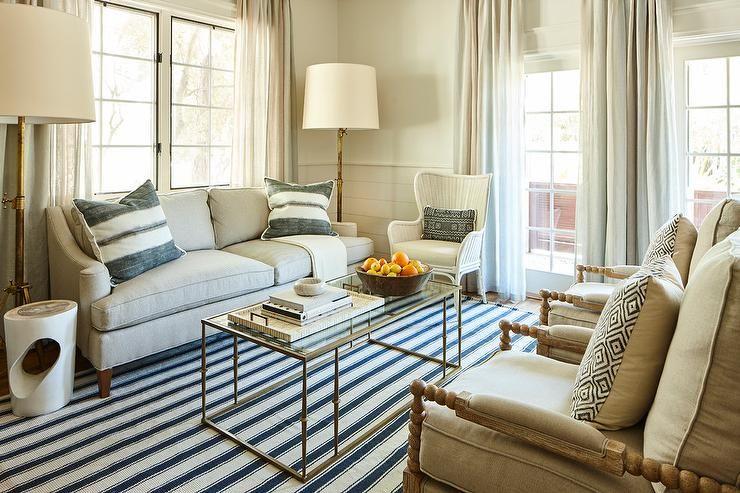 This Cozy Beach House Living Room Features A Light Gray Linen Sofa