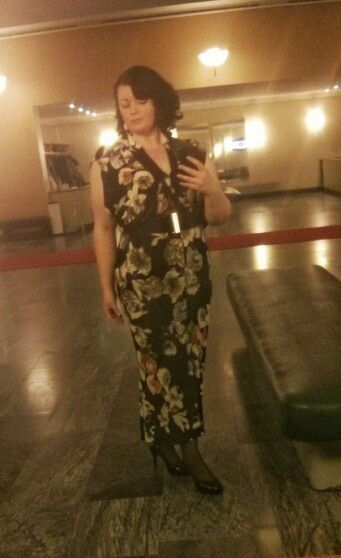 Floral patterned jersey dress. Black and gold belt and sequence pumps.