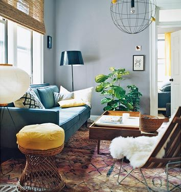 Blue Couch: Grey Walls, Yellow, Warm Wood, And Green. The Eclectic  Combination Against Those Blue Grey Walls. Love The Pop Of Yellow And The  Tonal Use Of ...