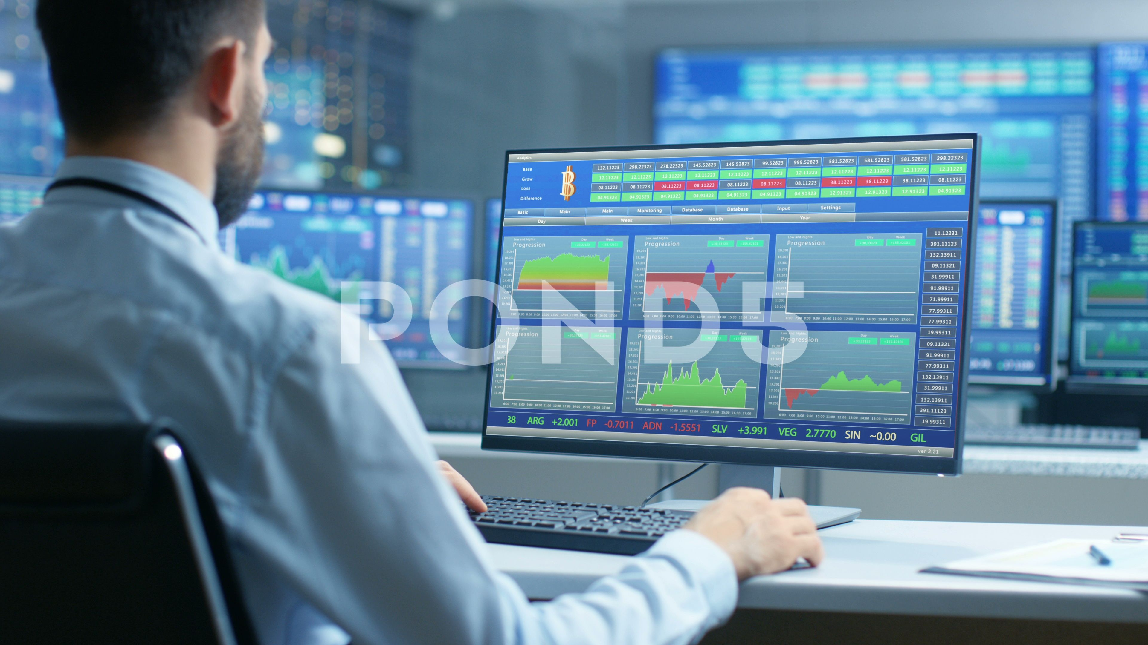 Stock Market Trader Observes Up S And Down S Of The Market At His Workstation Stock Footage Trader Market Stock Footage Stock Market Marketing Ups And Downs