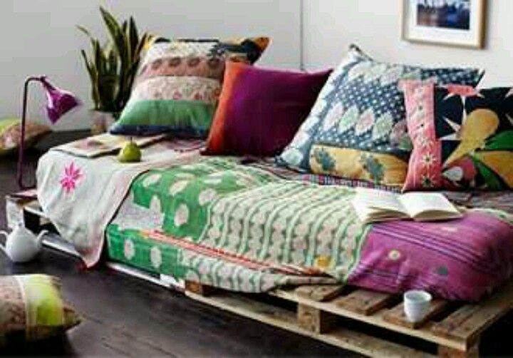 Palet sofa with layered kanthas - Similar kantha bedspreads from Decorator's Notebook www.decoratorsnotebook.co.uk