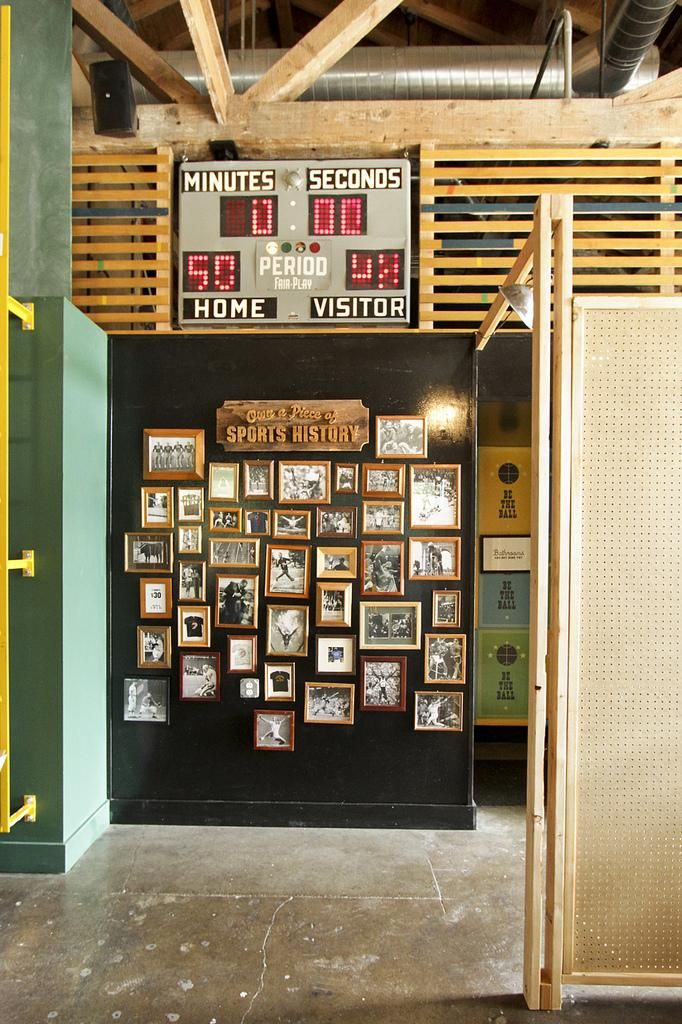 Historic Pictures And Scoreboard Sports Bar Decor Sport Bar