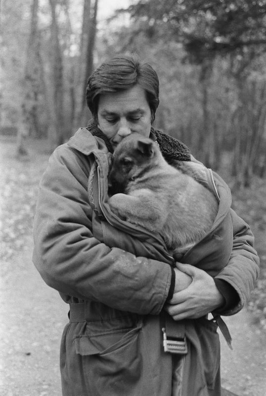 Alain Delon and puppy. M. Delon takes in strays to this day - not only handsome and talented, but compassionate! THANKS Mr. Delon