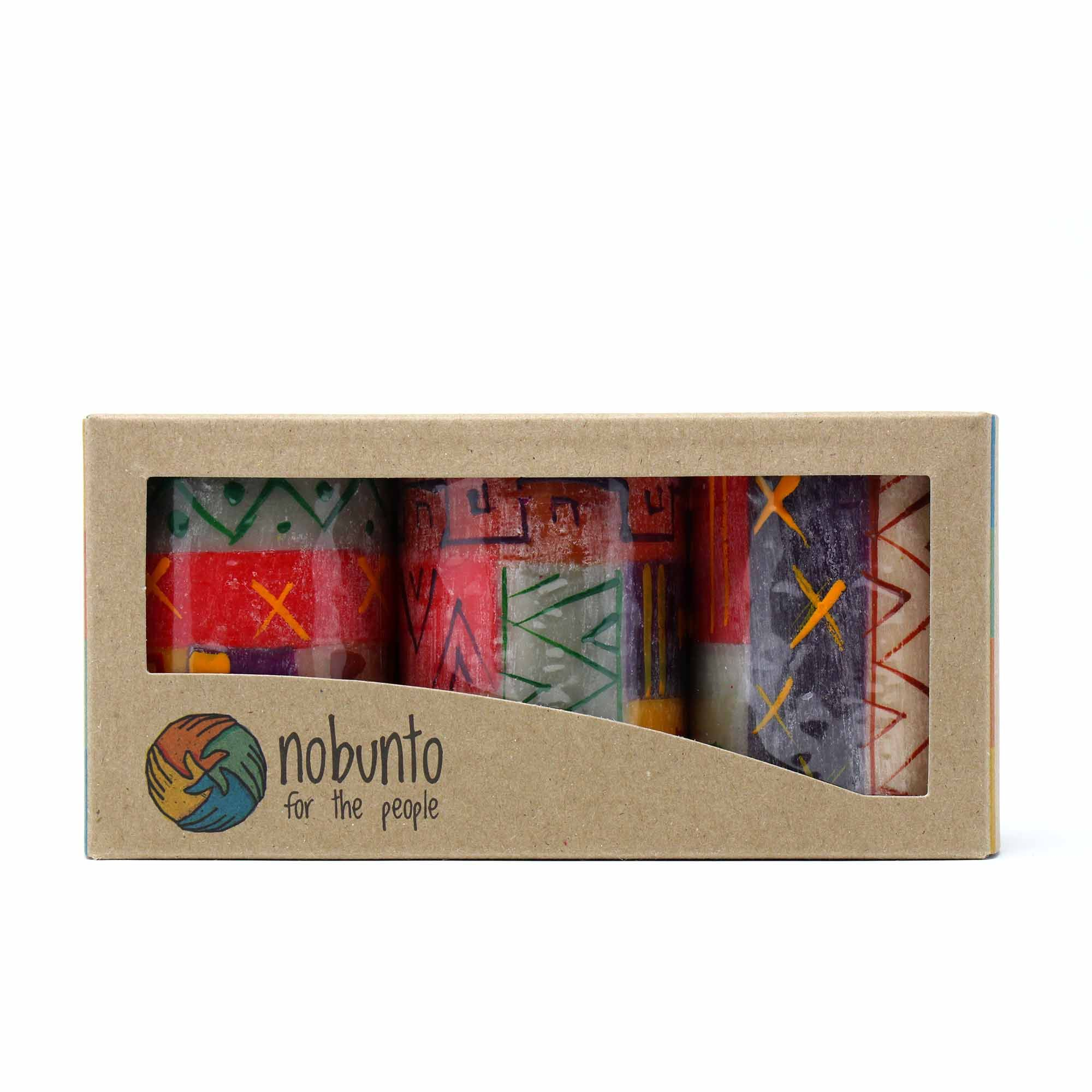 This set of three hand-painted candles comes in gift box. each candle is 2.5 inches tall by 1.75 inches in diameter. Meet the Artisans NOBUNTO is a South African Fair Trade company that creates high quality hand-painted candles, ceramics and handcrafted greeting cards with the utmost attention to detail using mainly African inspired designs. Their mission is, in a region with high unemployment, to alleviate poverty, not only through development of industry but to be socially, ethically, and sust