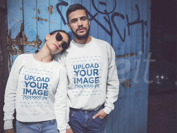 Download Placeit Happy Couple Wearing Different Crewneck Sweatshirts Mockup While Standing Against A Blue Door Crew Neck Sweatshirt Sweatshirts How To Wear
