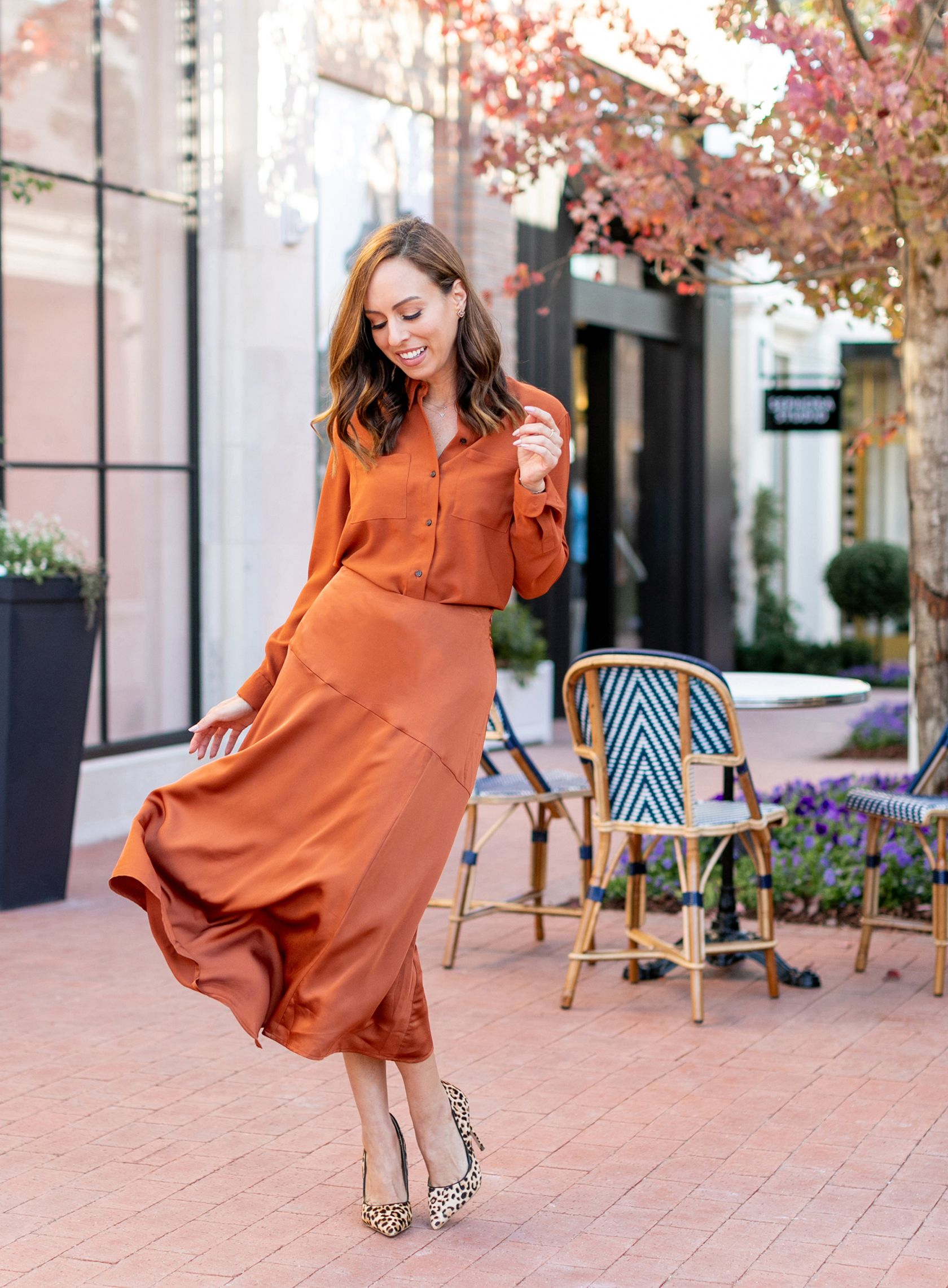 3dc93ca453 Sydne Style shows work outfit ideas in button down shirt and slip skirt   rust  orange  silk  officeoutfits  sydnesummer