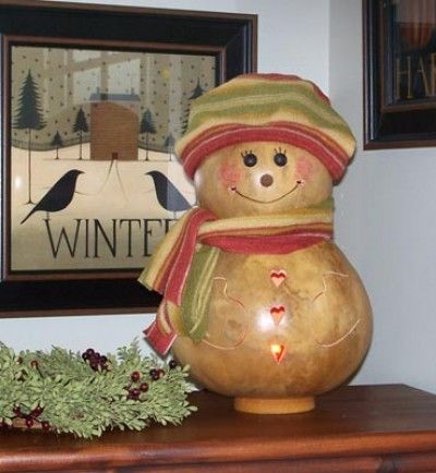 "Our new snow lady is natural in color. Her cheeks are rosey red from the cold chilly air. She is approximately 8"" in diameter and comes with an electric light."