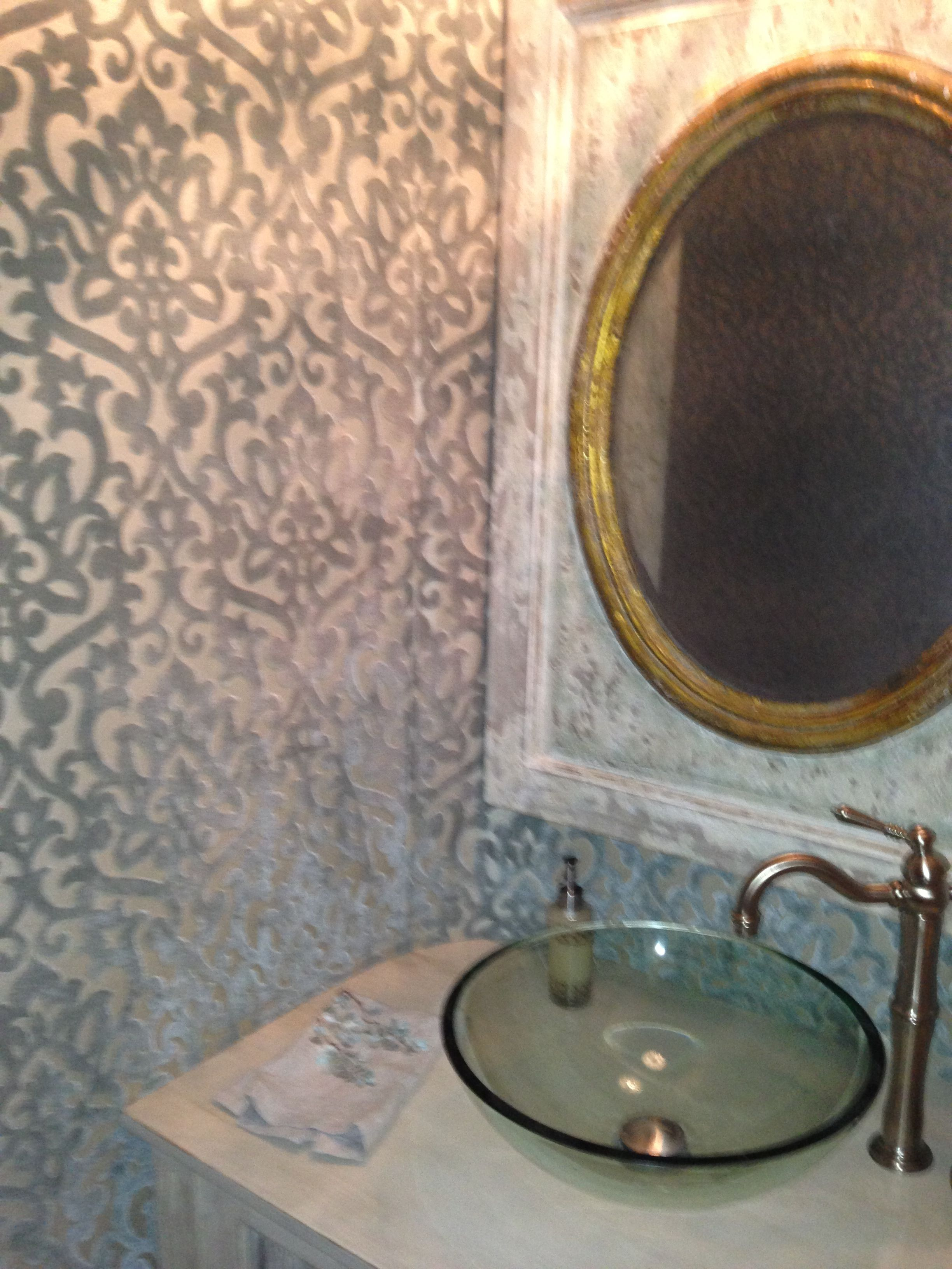 Ornate guest bathroom. Fabric wallpaper. Rolled edges.