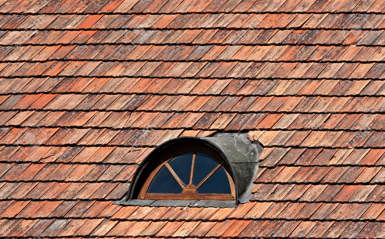 Arched Dormer Windows With Metal Sheet Cladding On Weathered Red Concrete Tile Roof Charming Dormer Windows A Window Architecture Window Construction Cladding