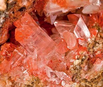 Gypsum crystals in bright cherry-red color caused by rich inclusions of Botrygen (rare) | Sierra Gorda District, Tocopilla Province, Antofagasta Region, Chile
