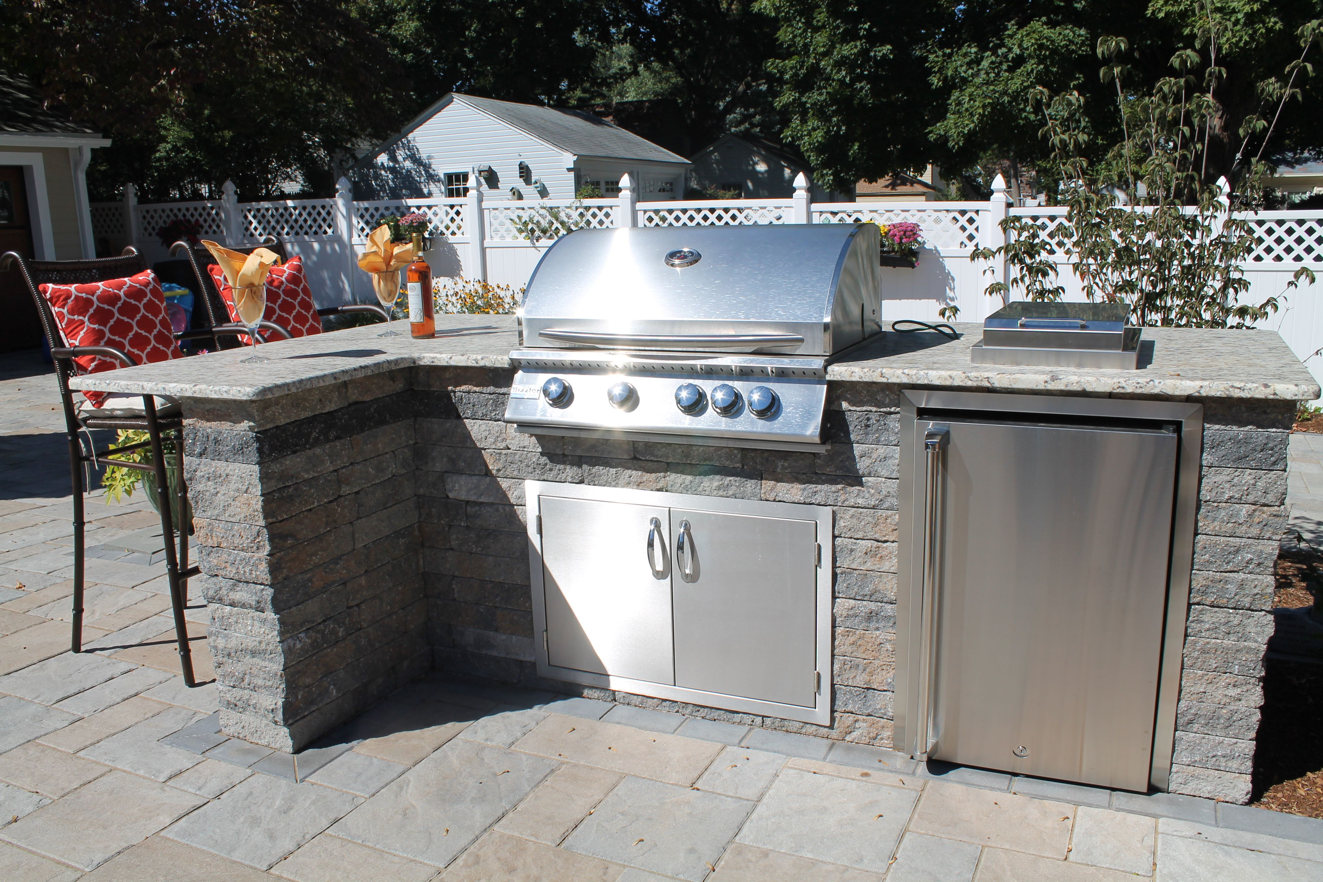 Outdoor Kitchen With Granite Counter Tops Built In Grill And Side Burner Refrigerator And Bar Area Outdoor Kitchen Countertops Built In Grill Outdoor Kitchen