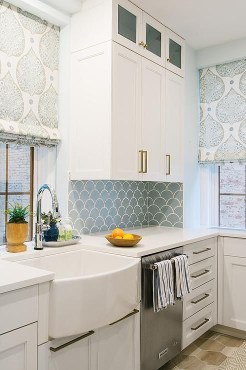blue fish scale backsplash tiles line walls fitted with white