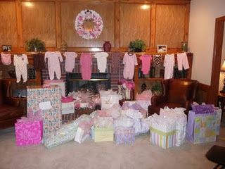 Love the line of outfits add a few diapers and it will for Baby shower hall decoration ideas