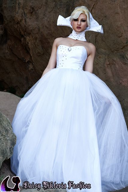 White tulle and crystals princess gown with stand-up collar neck corset.  Model: Jocelyne Watts  Photographer: Chris Taylor  Hair: Shelley Grey  http://www.daisyviktoria.com