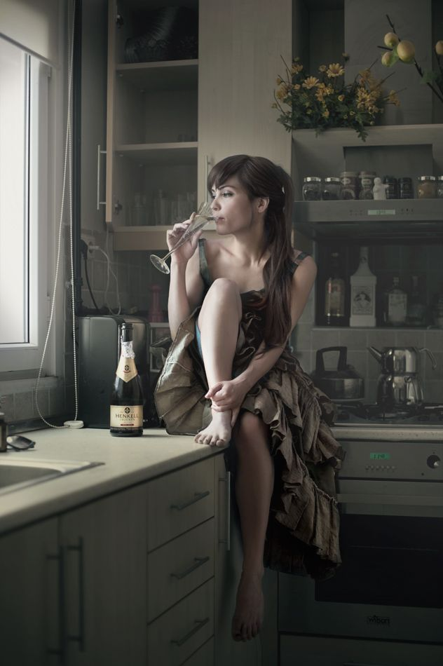 Sitting on the kitchen counter in a pretty dress drinking for Naked in kitchen pics