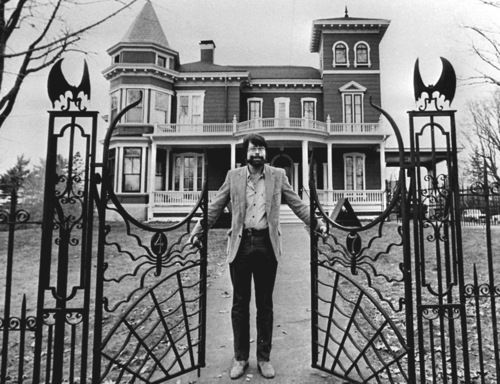 Love the gate (that's Stephen King in front of his house).