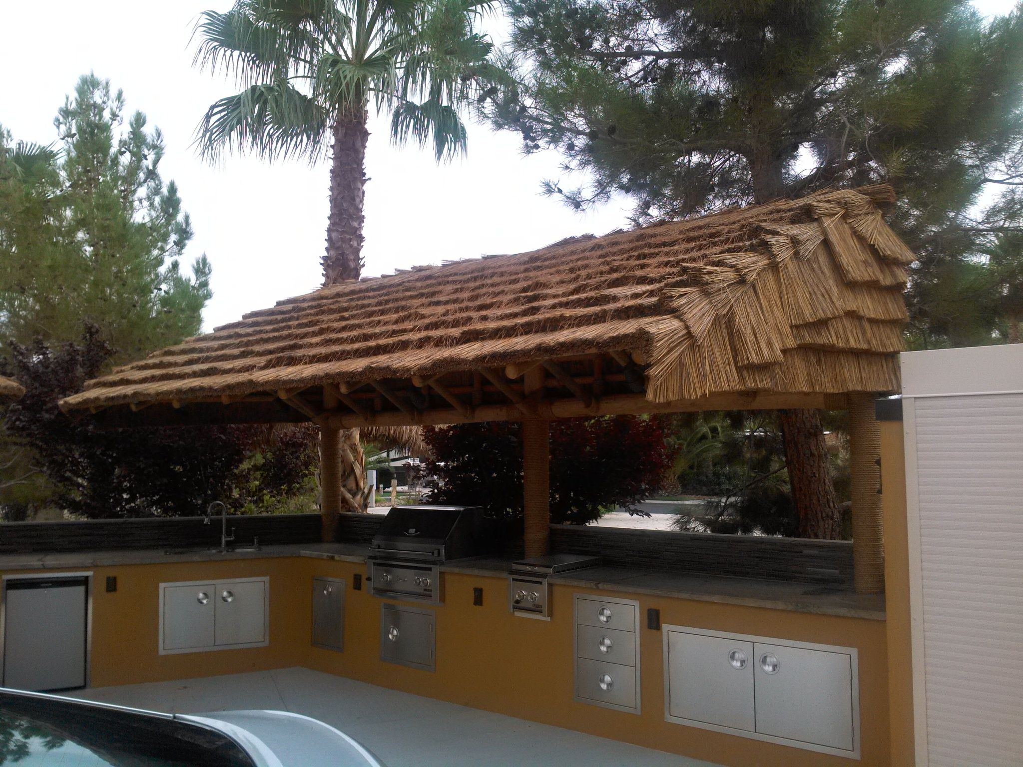 Attractive Cantilevered African Reed Palapa And Outdoor Kitchen.
