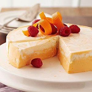 How can a cheesecake this decadent only have 124 calories per slice? By calling for reduced-fat cream cheese and light Greek yogurt for the citrus-flavored base.
