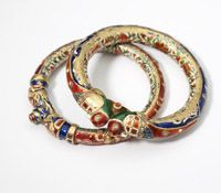 Lot# 008 Two Indian enamel and gemset animal bangles, Sold $4200