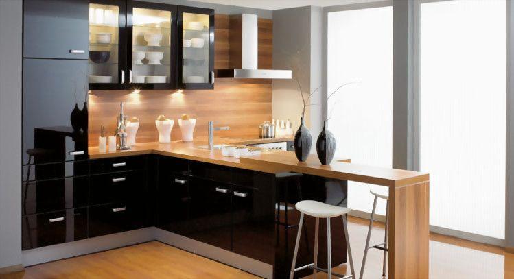 Preciosa cocina en negro alto brillo. muebles superiores con ...