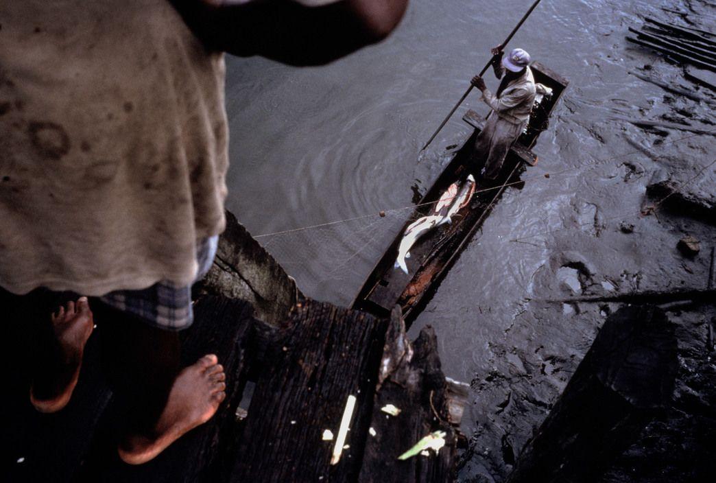 Alex Webb - Ecuador. 1999. El Viento. From the pier.