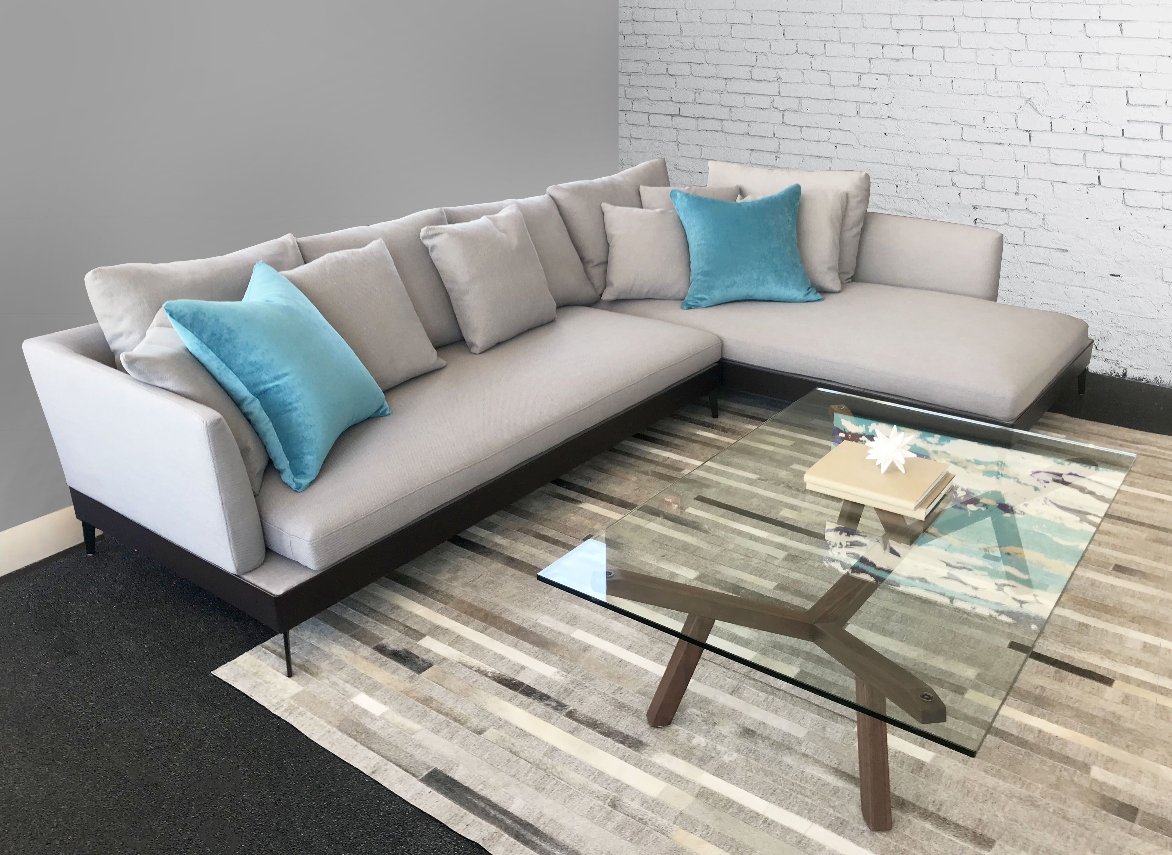 Modern vides , sleek design , vivid  accents ...Our Slate Sectional is ready to be viewed in any of our stores. Featured in light greys + beiges ; It can be customized to the dimensions and upholstery of your preference ;it is made in steel frame , down feather cushions, removable covers and ...a lifetime warranty!!! You will be  impressed with the quality👌... after-all ...Quality in Sofas is what we are known for !!!❤️