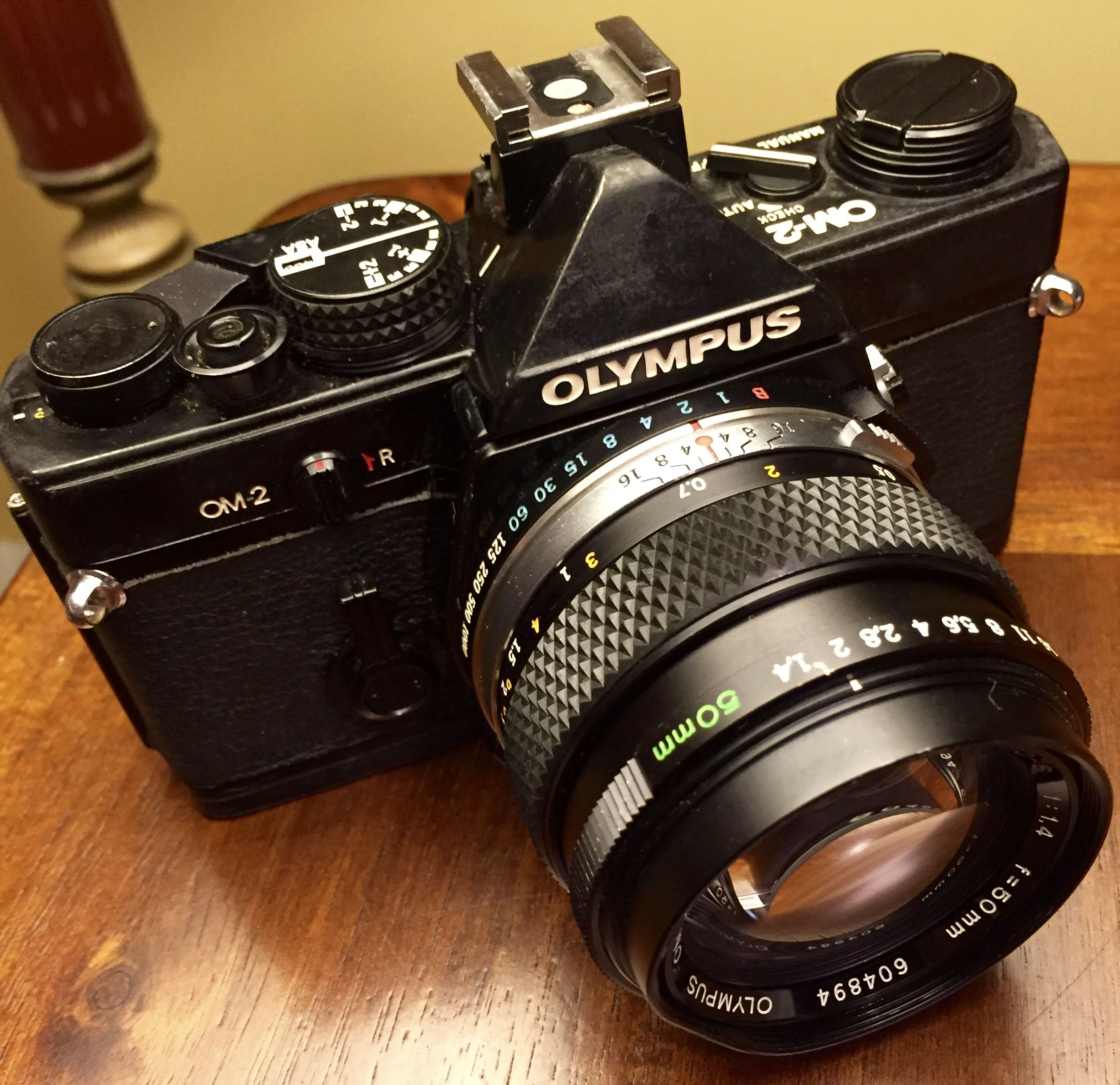 Olympus OM-2, 1975. It was the first camera to offer a TTL direct metering system for film, named Auto Dynamic Metering (ADM)