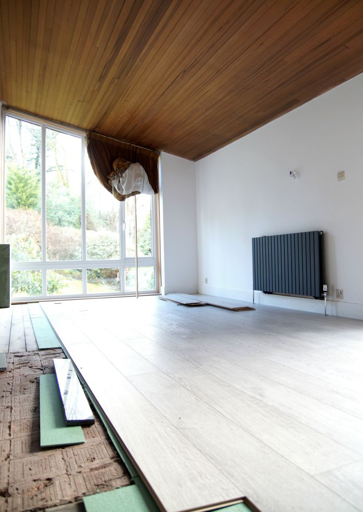 Light rustic oak laminate flooring by Quick Step Renovation project