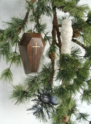 a coffin ornament to remember the dead during the holiday time, i would put a cameo picture instead of a cross