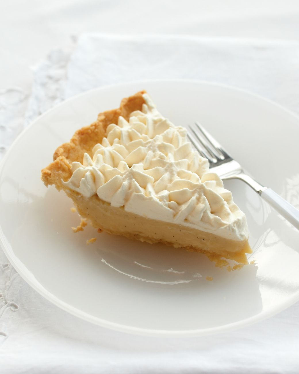 Consider this pie from our Pies & Tarts book comfort food for grown-ups. Rum adds a spirited kick to both the custard filling and the whipped cream topping. A vanilla bean does double duty, as well: Its seeds dot the filling, and the pod infuses the whipped cream topping with a delicate flavor.
