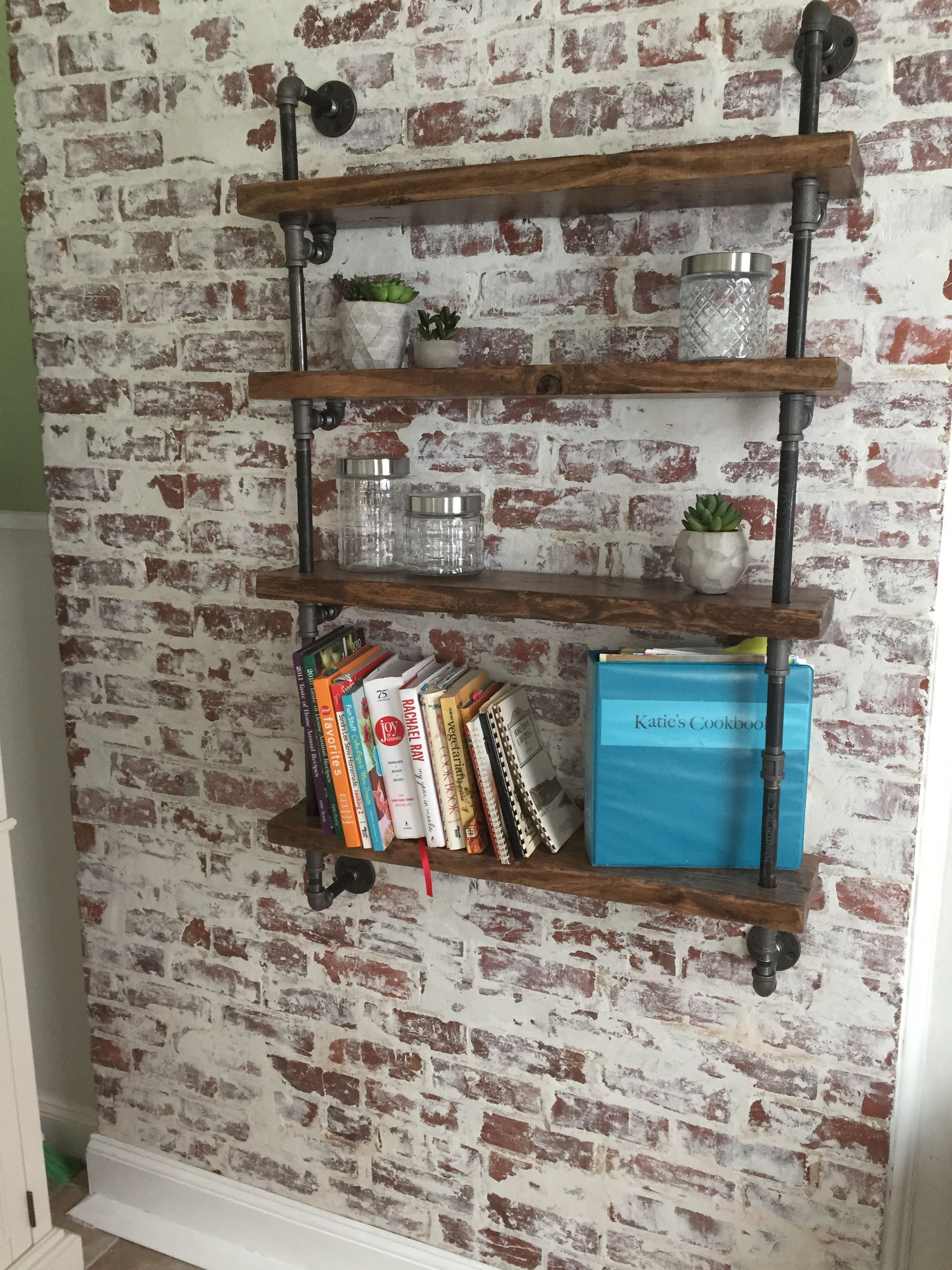 German Smear brick wall with industrial pipe shelving Epiphany