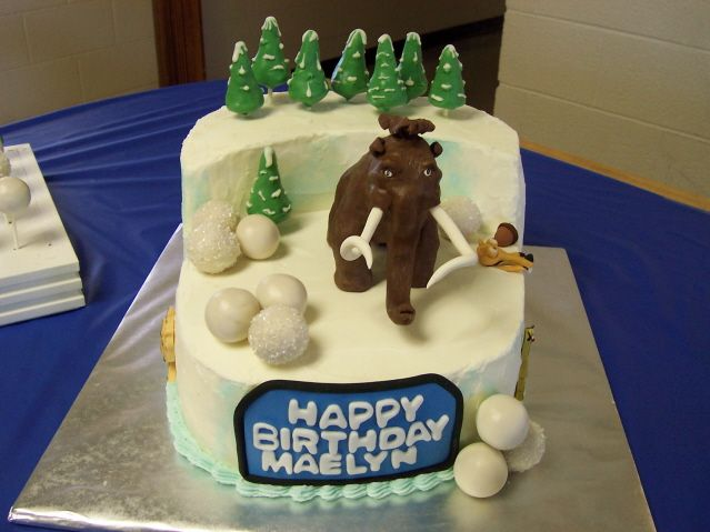 Ice Age cake with chocolate elephant and cake pop decorations