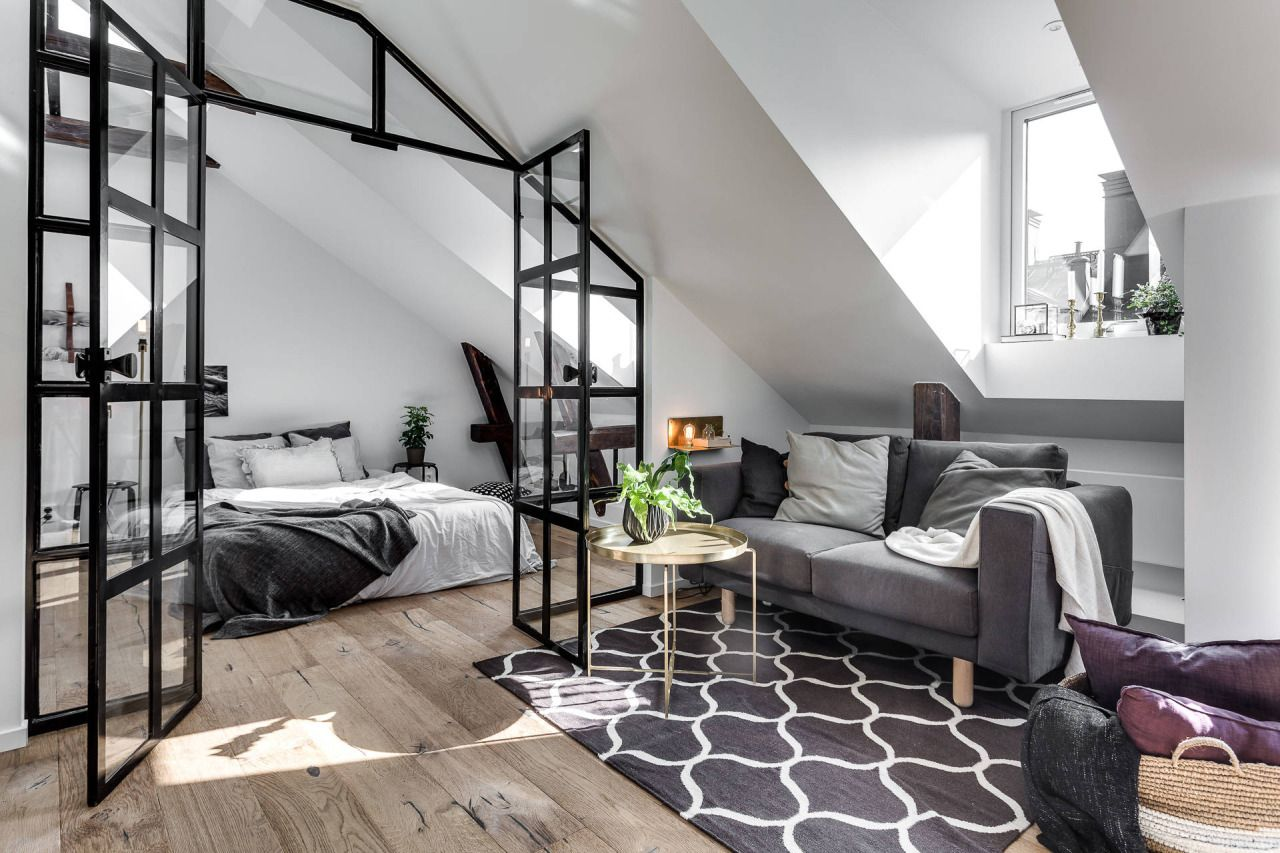 Attic apartment with industrial glass wall Follow