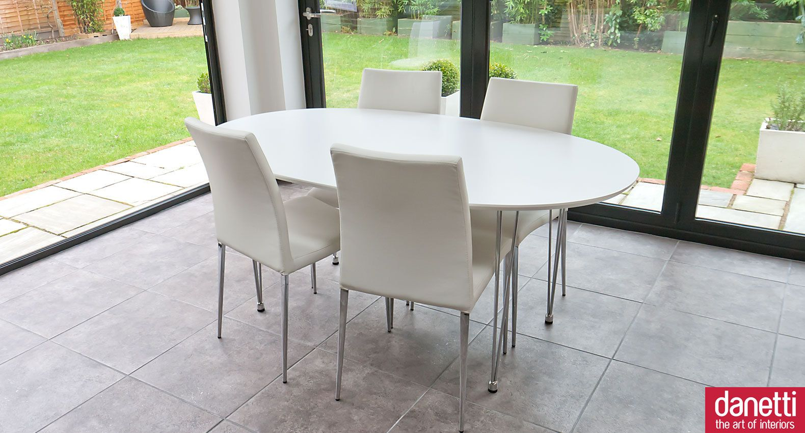 The Modern Ellie White Oval Dining Table Has A Smooth Oval Shape And Stylish Slim Legs The Tact Comfortable Dining Chairs Dining Sets Modern Oval Table Dining