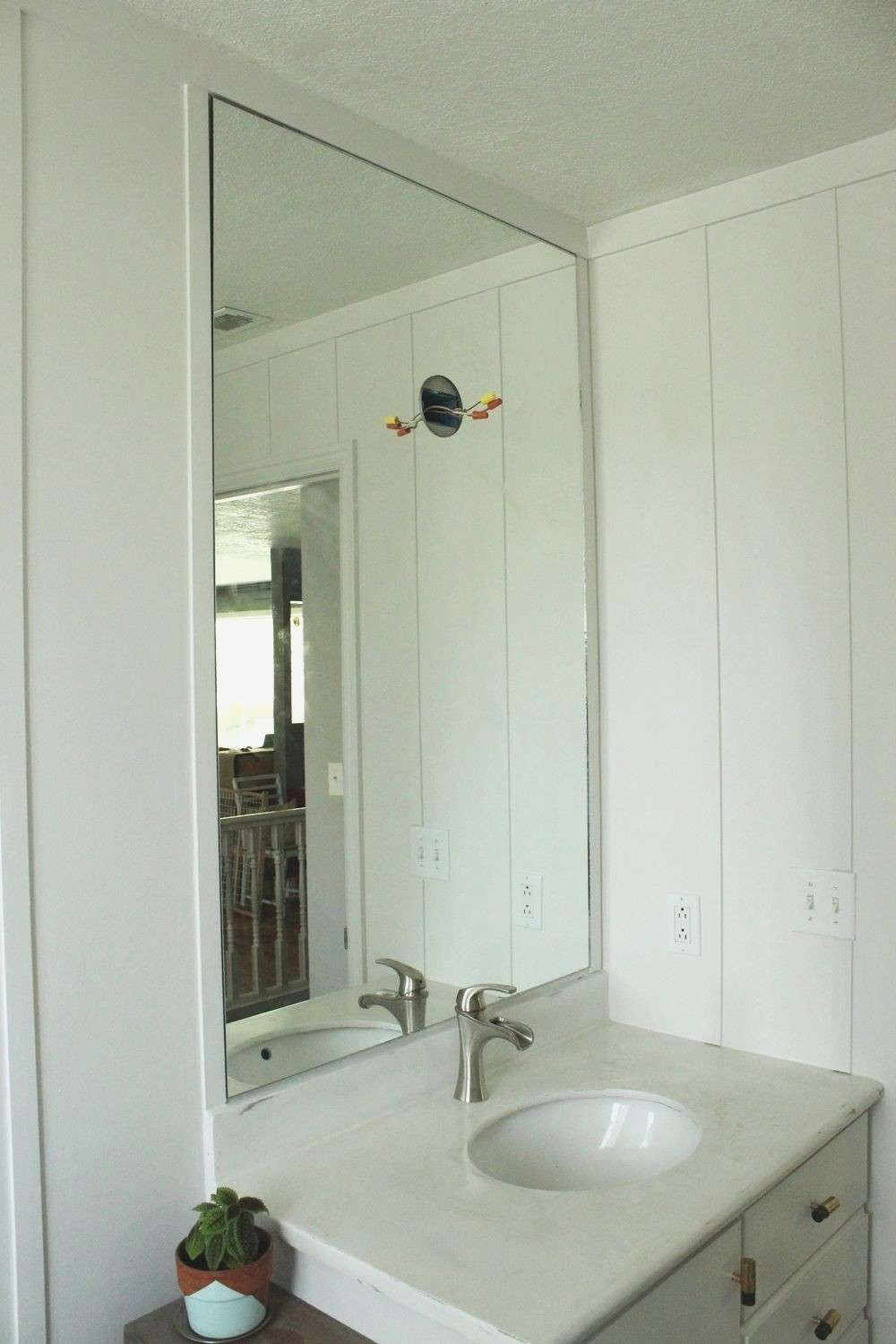 how to remove bathroom mirror stuck to wall