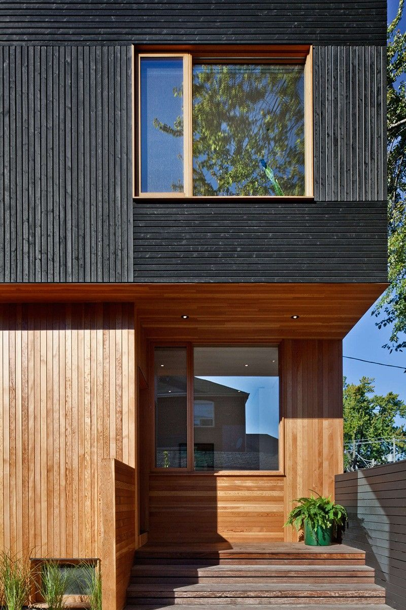 Black siding with natural wood accents for this toronto for Modern exterior wood siding