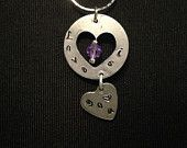 This beautiful item comes strait from the heart. These metal stamped, sterling silver pendants have been sealed to prevent future tarnishing. Accented with a purple crystal to add a simply sweet finish to this beautifully simple necklace. It is sure to be a hit gift for anyone needing or wanting a simple, yet attractive accent piece for any wardrobe!   EBay: http://www.ebay.com/itm/321750528742?ssPageName=STRK%3AMESELX%3AIT&_trksid=p3984.m1555.l2649