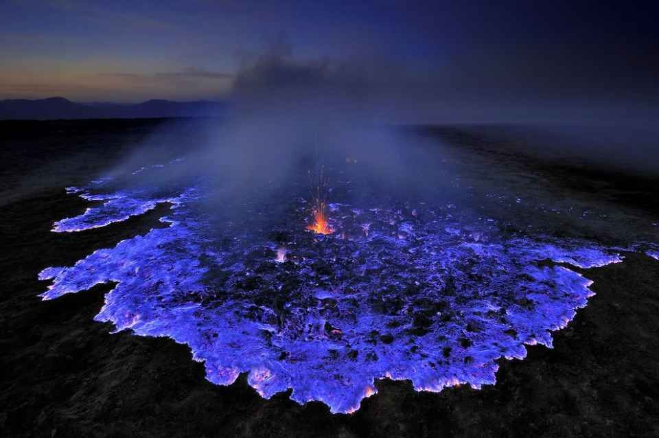 Incredible Neon Blue Lava Erupts From Indonesias Kawah Ijen - Incredible neon blue lava flames erupt volcano