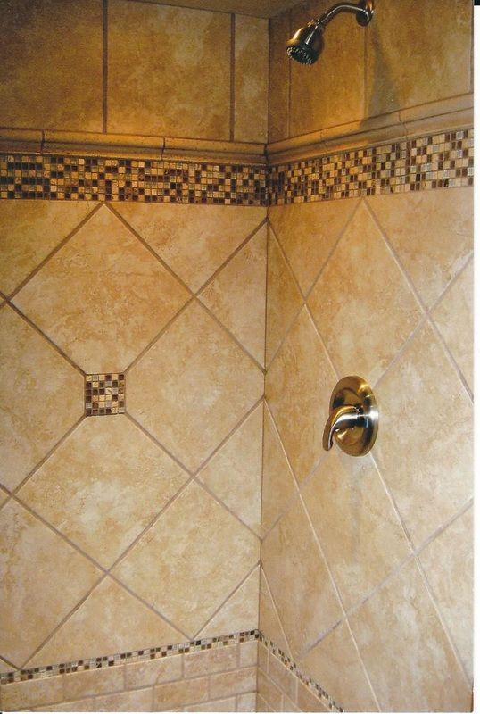 Warm Beige Tiled Shower With Varying Sizes And Patterns Including Brick Lay,  Diagonal And Stacked In The Porcelain Tile With Glass Mosaic Accents.