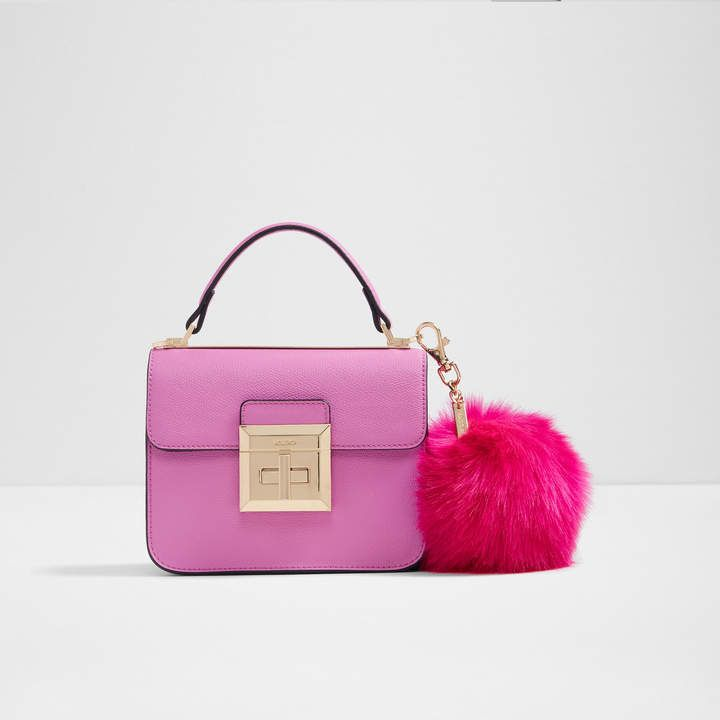6ae7699e138 Aldo Chiadda. Mini bag. Big on style. A fabulously fun oversized pom pom  adds major style points. Featuring a turn lock closure and hanging luggage  tag.