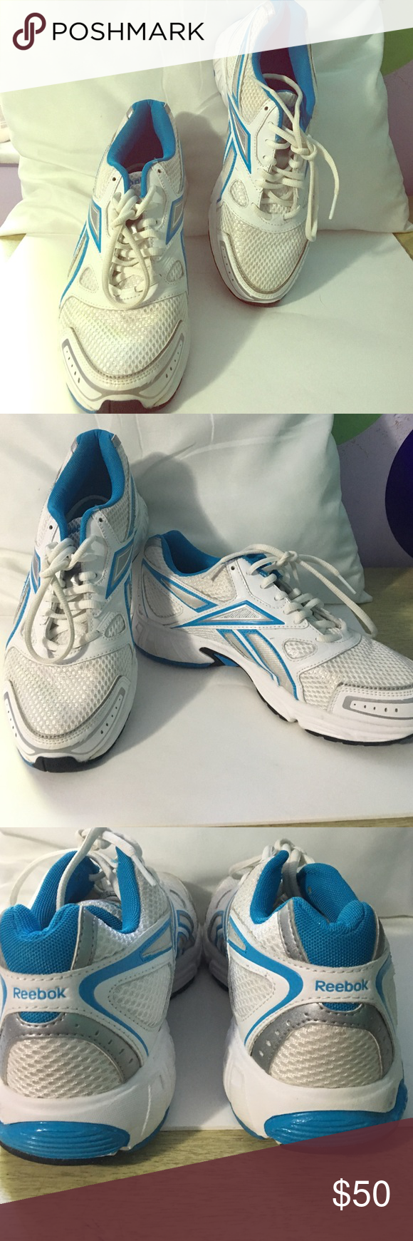 White and blue tennis shoes Worn a few times. Still in great condition Reebok Shoes Athletic Shoes