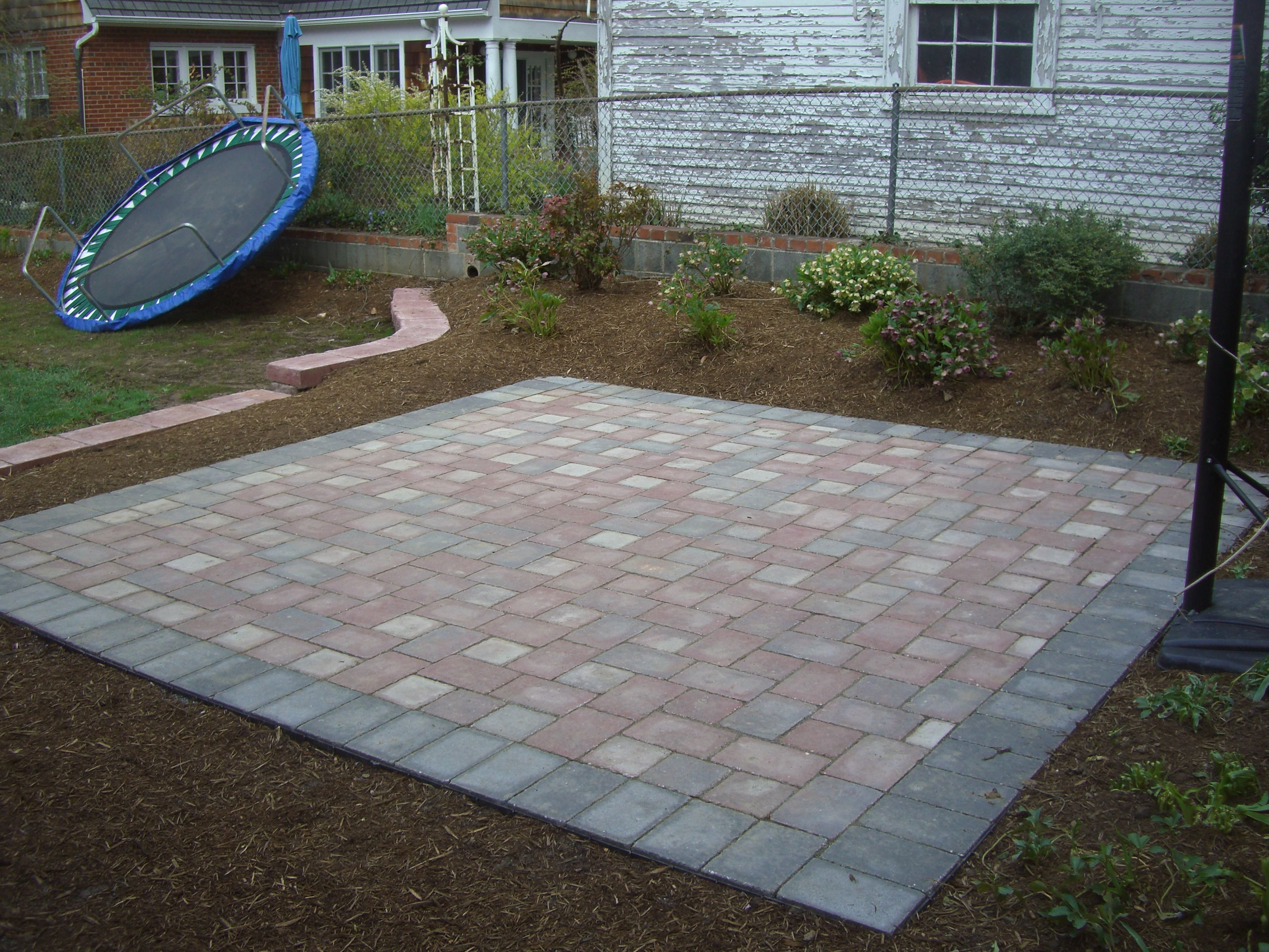 this  patio garden is conveniently located in your yard allowing room for a basketball hoop as