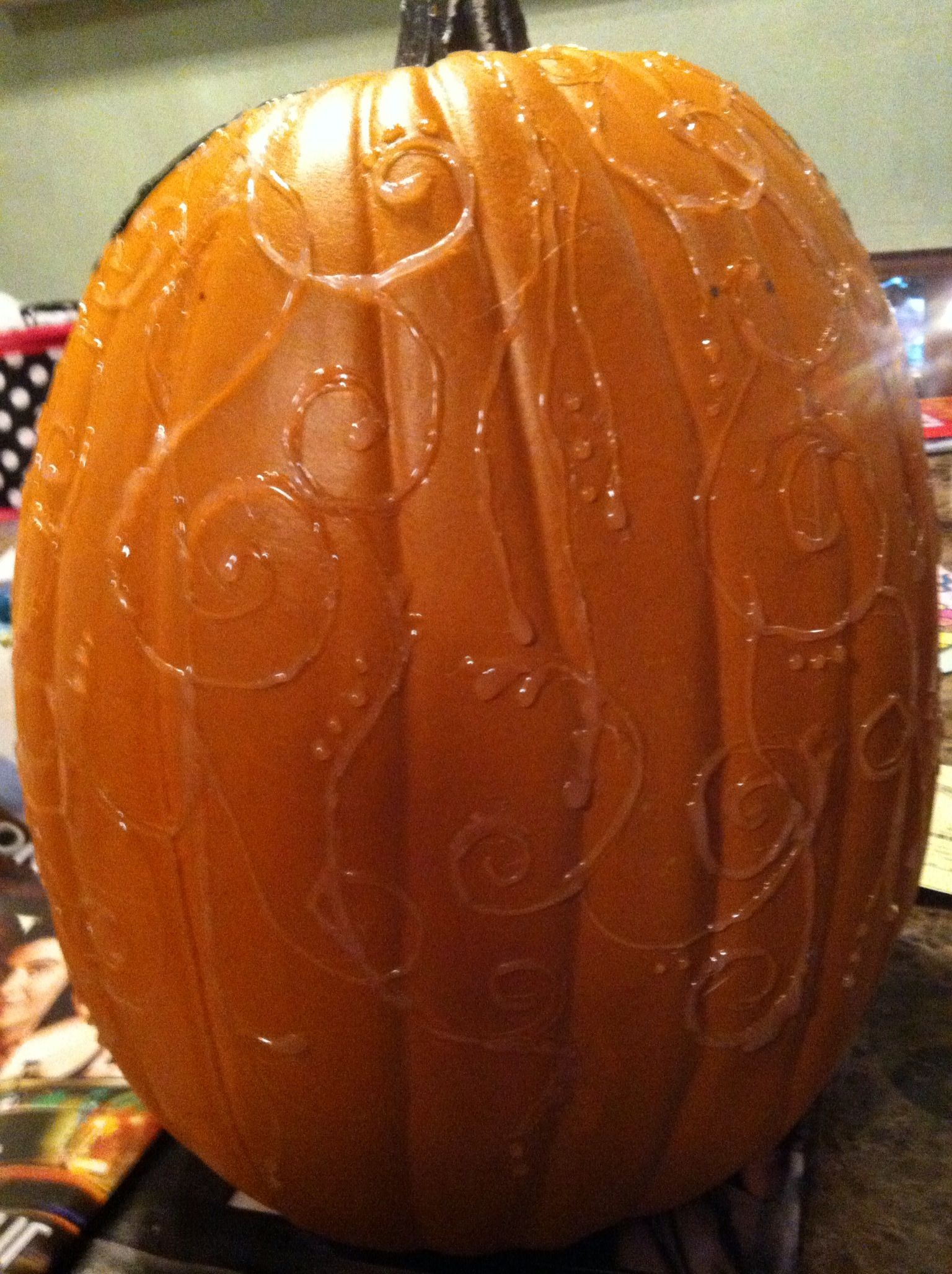 Hot glue designs on a pumpkin.  Then paint any color you want. Easy. Cheap. And FUN!