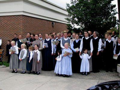 Mennonite Choir performs on St. Jacobs main street - Ontario.