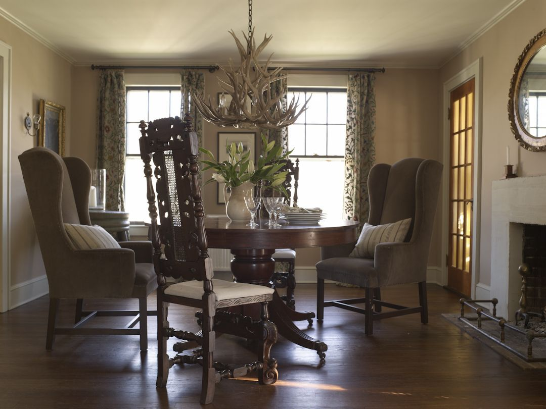 Dining Room With Fireplace Plaster Walls And Antler Chandelier