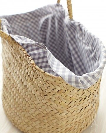 Basket with Liner  Easy to make and functional, the liner for this basket is essentially a tube of fabric cut from the bias. It gets cinched at one end (for the bottom of the basket), while the other end is folded over the edge of the basket.