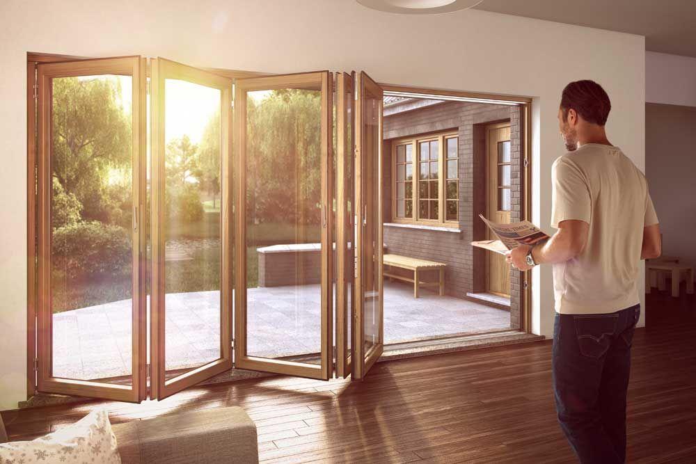 A five panel Sunflex SF75H timber bi-folding door system & A five panel Sunflex SF75H timber bi-folding door system | Bifolds ...