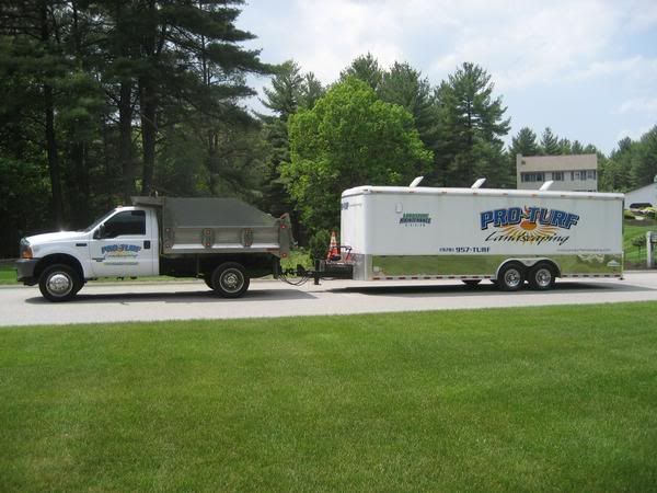 Pictures of trucks with decals and logos for Landscaping business
