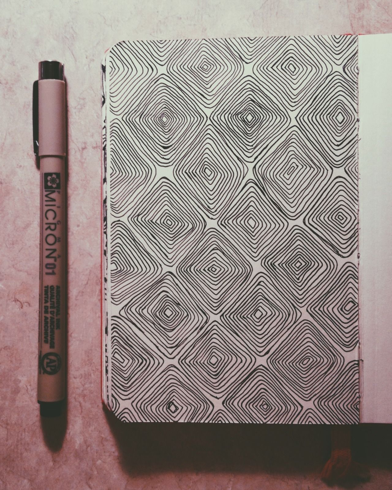 I really like patterns. Done with microns in my little red moleskine ...