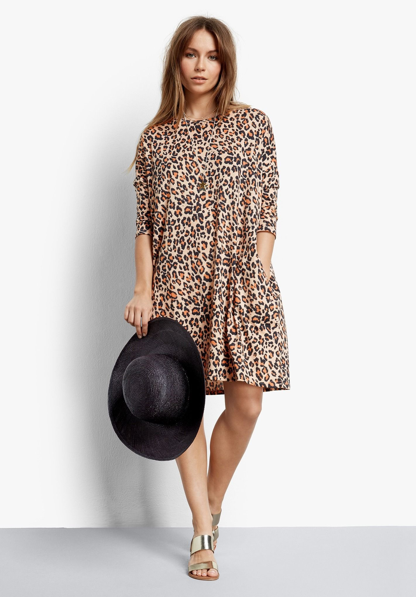 8607b0abc A modern take on the T shirt dress, in eye-catching leopard print, the  oversized style creates a cocoon shape that's on-trend and so easy to wear.